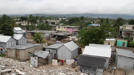 homeless : pan over earthquake damaged neighborhoods Port-au-Prince Haiti Stock Footage