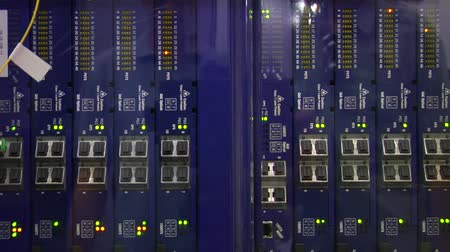 telekomünikasyon : close up on racks of computer equipment with flashing lights