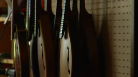 gitáros : shot of stringed instruments hanging on the wall