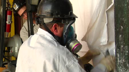 respirator : worker in respirator opens bag of chemicals Stock Footage