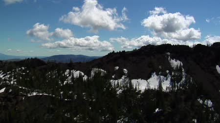 animal protection : Aerial shot of mountains covered in melting snow Stock Footage