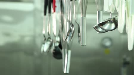 chef cooking : Pan of professional cooking tools hanging in line