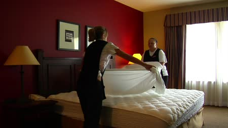 sheet : housekeepers in the hotel room change bedding