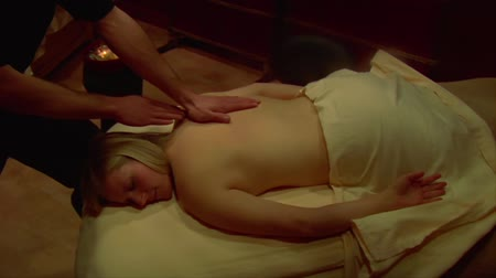 massages : blonde woman is massaged Stock Footage