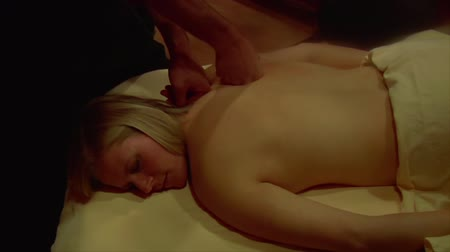terapia : blonde woman is massaged pullout