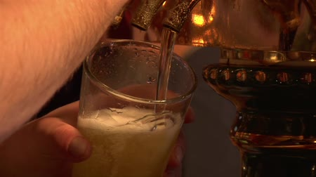 beer tap : Close-up of beer pouring from tap Stock Footage