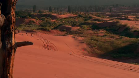 ATV riders on red sand dunes