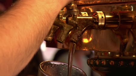 beer tap : close-up of beer pouring from