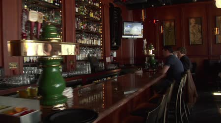 alkol : steadicam shot through bar past patrons