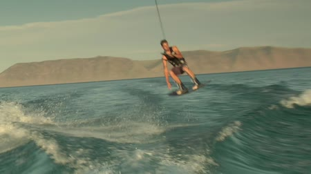 Teenage boy wakeboarding Wideo