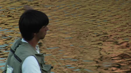 osamělost : tight shot on young  Fly fisherman casting