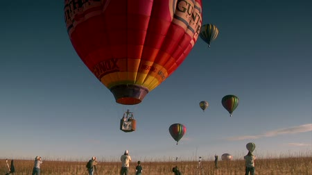 fotky : colorful hot air balloon liftoff with spectators taking photos
