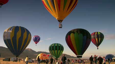 léggömb : spectators watch as hot air balloons ascend into the sky