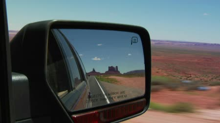 filmes : Monument Valley Highway in rearview mirror Stock Footage