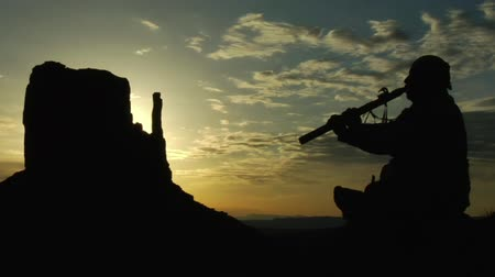 Native American playing flute with Monument Valley sunrise Wideo