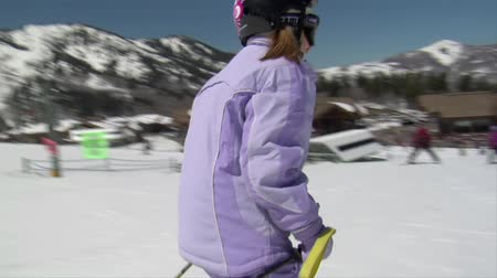 bezmotorové létání : Little skier dressed in pale purple snowsuit