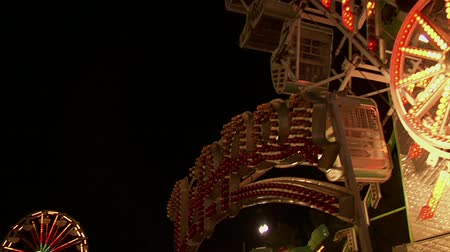karnawał : The Zipper of ride at a carnival Wideo