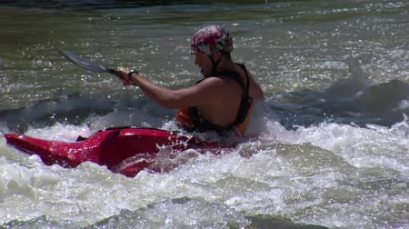kayak : man paddles in Rapids using white-water kayak