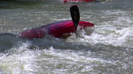 man flips white-water kayak in slow motion