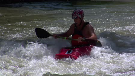 kayak : man paddles in Whitewater kayak slow-motion