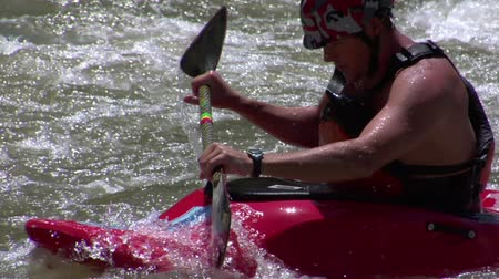tired man paddles white-water kayaking slow-motion