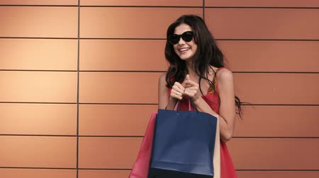 holding steady : Portrait of happy young woman after shopping