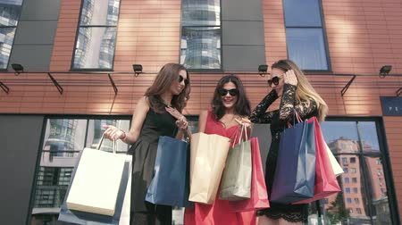 pitka : Portrait of three female friends discussing their purchases