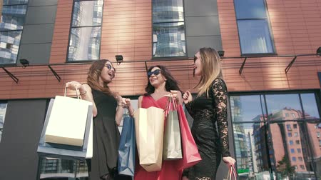 решение : Three attractive female friends meeting after shopping day