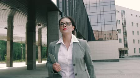 delegate : Young attractive business woman being late for the meeting