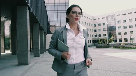people go to work : Beautiful business woman running and looking at the time Stock Footage