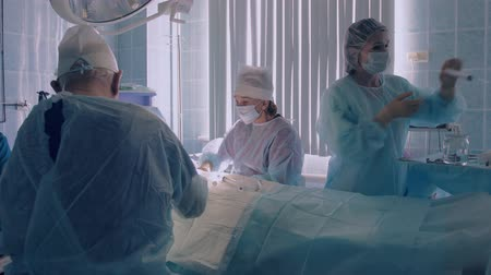 surgical instrument : Group of surgeons starting surgical operation Stock Footage