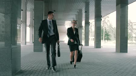 motive : Business man escorting woman from delegation to the business center and her hotel