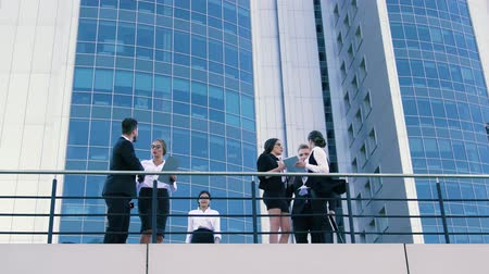 ambition : Coworkers meeting each other on the terrace