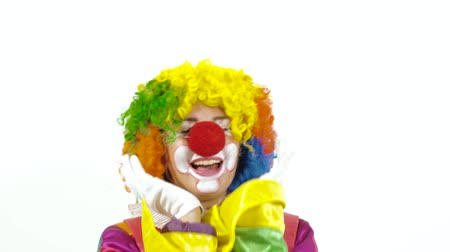 тревожный : Close-up of young hilarious clown making funny faces