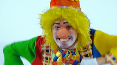 insincere : Close-up of excited male clown running toward the camera and smiling widely