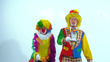 insincere : A couple of circus clowns playing with pancakes and frying pans Stock Footage