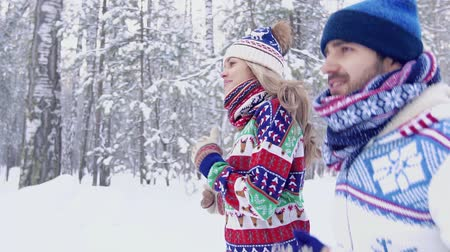 toboggan : Lovely couple in colorful clothes enjoying their training in nature Stock Footage