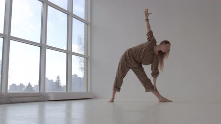 Sporty yoga woman practicing yoga poses in studio