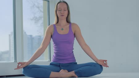 Portrait of attractive calm woman relaxing while meditation Stock Footage
