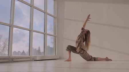restorative : Young woman practicing low lunge pose from yoga