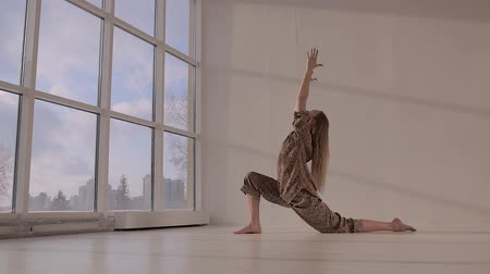 Young woman practicing yoga and doing lunge
