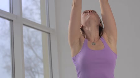 Portrait of girl doing breathing exercise to calm her breathing and relax Stock Footage