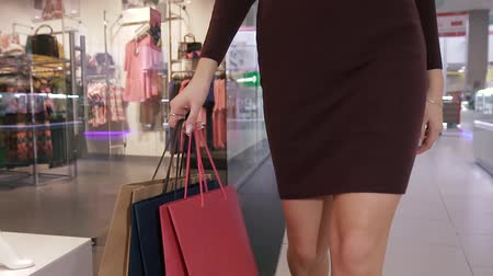 latino americana : Close-up of slender female body walking in shopping mall