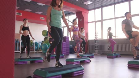 gymnastics : Step group training, smiling people doing exercise Stock Footage