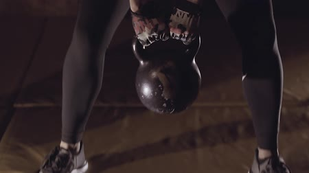 vzpírání : Close-up of sporty young woman working out with kettle ball.