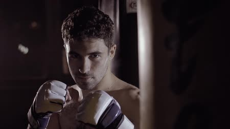 poddasze : Portrait of muscular man getting ready to boxing exercise. Wideo