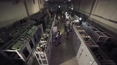 yalıtım : High-angle shot of factory workers working with electric meters.