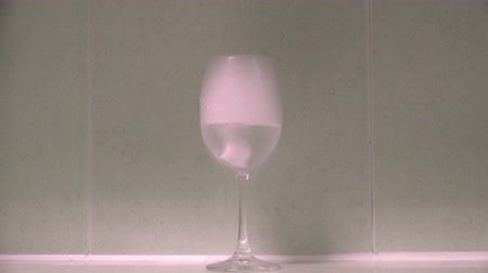 Dry ice smoke is overflowing with wine glasses.