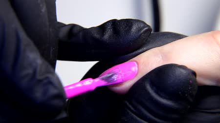 cuticle : Nail polishing using an electric manicure drill machine. Hardware dry manicure process in beauty salon.