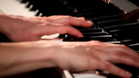 sonata : Two hands playing on a beautiful grand piano.